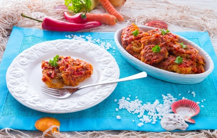 fish in Greek kind with vegetables and tomato sauce