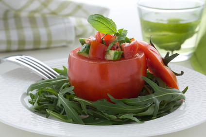 Salad from cucumbers and tomatoes in tomato